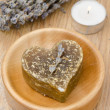 Bath soap with lavender in a heart and a candle — Stock Photo