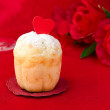 Rum Baba decorated with hearts on a red background — Stock Photo