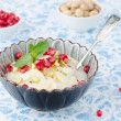 Stock Photo: Semolindessert with pomegranate seeds and pistachios in bowl