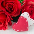 Canvas handmade hearts and red roses for Valentines day — Stock Photo