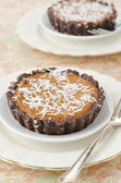 Chocolate tarts with cream and coffee closeup — Foto Stock