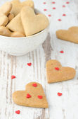 Heart shaped cookies on the table and a bowl of cookies — Stock Photo