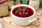 Ukrainian and russian national red borsch with herbs horizontal — Stock Photo