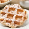 Homemade waffles topped with powdered sugar for breakfast — Stock Photo