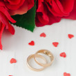 Red roses, rings and sugar hearts for Valentine — Stock Photo