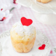 Rum Baba decorated with red hearts on a plate — Stock Photo