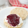 Royalty-Free Stock Photo: Scone with goat cheese and jam on a plate closeup vertical