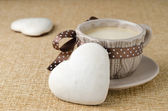 Cookie with icing in the form of heart and a cup of coffee — Stok fotoğraf