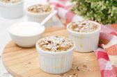 Apple cake with nuts in a white ramekin horizontal — Stock Photo