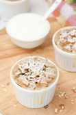 Apple cake with nuts in a white ramekin top view — Stock Photo