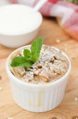 Apple pie with walnuts and mint in a white ramekin closeup — Stock Photo