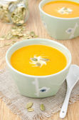 Bowl of pumpkin soup with ginger vertical — Stock Photo