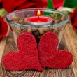 Red candle in a glass cup with coffee beans and two hearts — ストック写真 #19460377