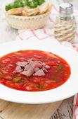 Ukrainian national red borscht on the plate vertical — Stock Photo