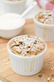 Apple pie with nuts in a white ramekin closeup — Stock Photo