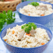 Two bowls Uzbek national dish pilaf closeup — Stock Photo