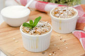 Apple pie with walnuts and mint in a white ramekin horizontal — Stock Photo