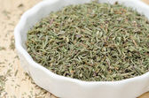 Dried thyme in a white bowl, selective focus, closeup — Stock Photo
