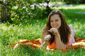 Girl is lying on the grass and smiling — Stock Photo