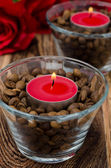 Red candles in glass jars with coffee beans closeup — Stock Photo