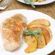 Baked chicken and saute quince with rosemary vertical — Stock Photo #22559869