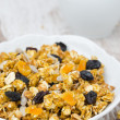 Pumpkin granola with dried fruit and seeds closeup — Stock Photo