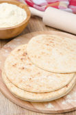 Wheat tortillas on a wooden board — Stock Photo