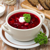 Ukrainian and russian national red borsch with sour cream — Stock Photo