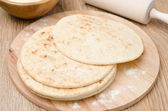 Wheat tortillas on a wooden board horizontal — Stock Photo