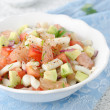Bowl of salad with squid, avocado and grapefruit - Stockfoto