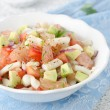 Bowl of salad with squid, avocado and grapefruit - Stock Photo