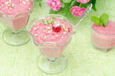 Raspberry mousse decorated with mint and fresh raspberries — Stock Photo