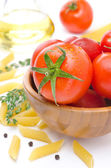 Fresh tomatoes, pasta penne, olive oil and spices closeup — Stock Photo