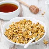 Pumpkin granola and honey — Stock Photo