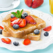 Crispy toast with honey and fresh berries for breakfast - Stock Photo