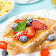 Stock Photo: Crispy toast with honey, fresh berries, cup of coffee