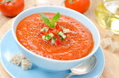 Cold tomato soup gazpacho with basil and croutons in a bowl — Stock Photo
