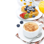 Cup of cappuccino, belgian waffles with blueberries — Stock Photo