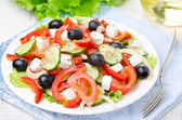 Greek salad with feta cheese, olives and vegetables, horizontal — Stock Photo