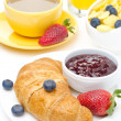 Breakfast with croissant, jam, fresh berries and coffee — Stock Photo #24729443