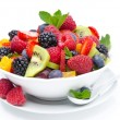 Royalty-Free Stock Photo: Salad of fresh fruit and berries in a bowl isolated, close-up