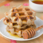 Homemade waffles with maple syrup and poppy — Stock Photo