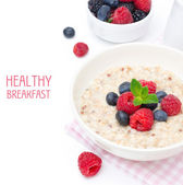 Healthy breakfast - oatmeal with fresh berries isolated on white — Stock Photo