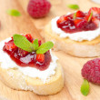 Постер, плакат: Toasted baguette with cream cheese raspberry jam and raspberry