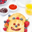 Stock Photo: Breakfast with smiling toast, fresh berries, jams, juice