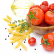 Fresh tomatoes, pasta penne, olive oil and spices on a white — Stock Photo