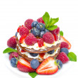Pancake cake with whipped cream and fresh berries isolated — Stock Photo #25402199