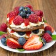 Stock Photo: Pancake cake with whipped cream and fresh berries on table