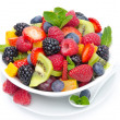 Salad of fresh fruit and berries in a bowl isolated on white — Stock Photo