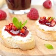 Toasted baguette with cream cheese, raspberry jam - Stock Photo